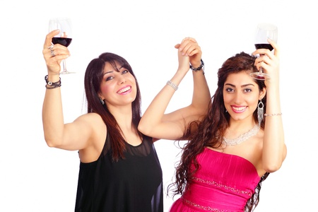 formal party: Two happy cheering women raising wine glass