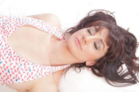 Beautiful woman asleep in bed Stock Photo - 18054575