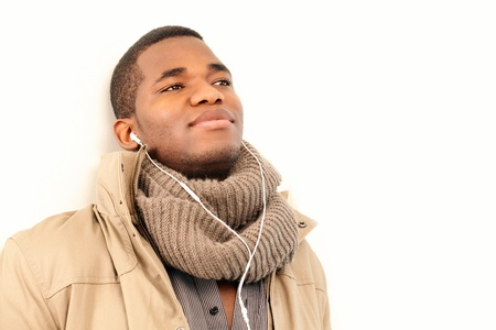 Listening to musis, young man with earphones photo
