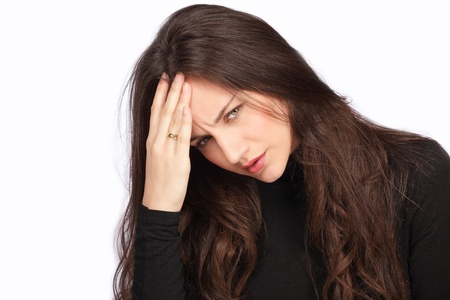 holding the head: Worry and stress, pretty woman holding head