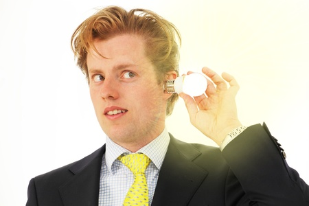 Energy saving human plugs light bulb in ear Stock Photo - 20002638
