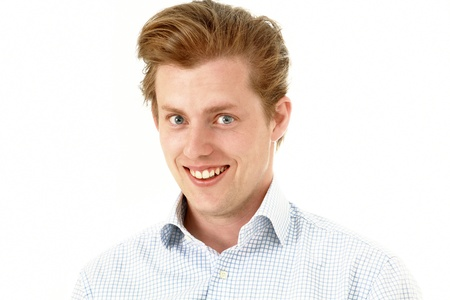 amused: Naughty smile, young man with amused look Stock Photo