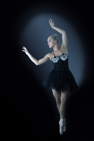 Ballet dancer in graceful pose photo
