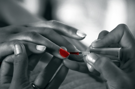 nail care: Applying nail polish in Beauty salon setting