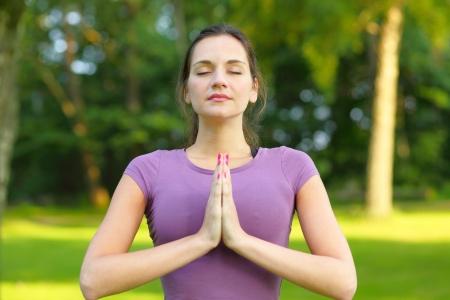 women s health: Morning yoga, young woman in fresh green nature