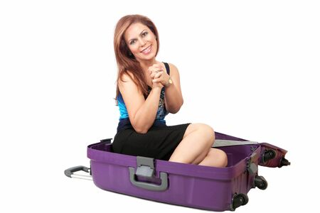 wants: Woman in suitcase, maybe wants to go on trip Stock Photo