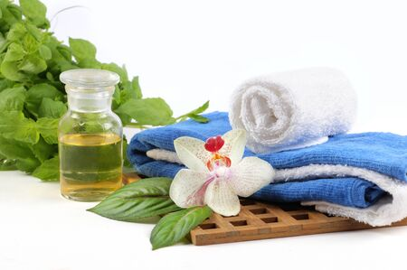massage oil: Fresh spa theme massage oil, towel, orchid greens