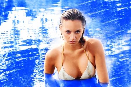 wet bikini: Beautiful swimmer in open water