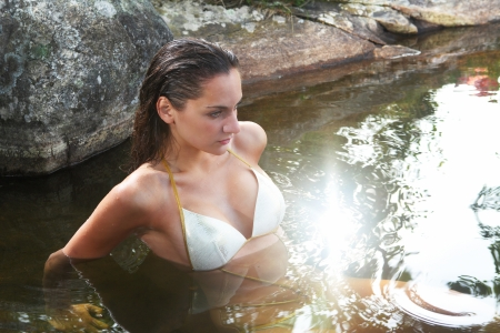 wet girl: Woman in spring water, peaceful relaxation