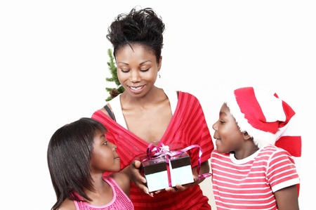 three gift boxes: Christmas family with focus on mom holding gift