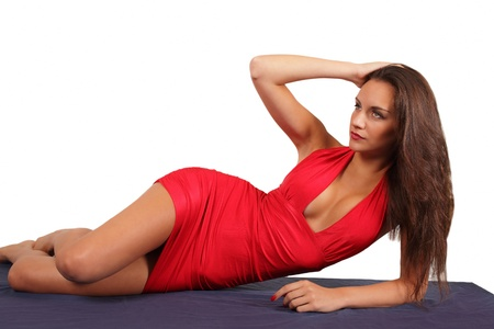 Model in red dress in reclining pose photo