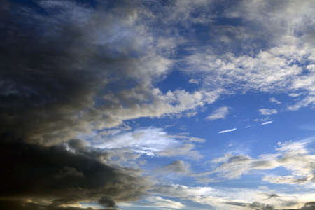 low light: Blue sky with drifting clouds Stock Photo