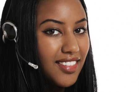 Telephone assistance, smiling operator with headset photo