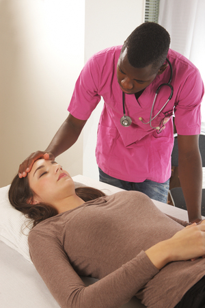 touch down: Hospital night care, woman and medical attendant Stock Photo