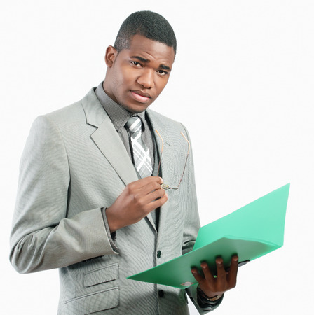african businessman: Serious businessman holding file