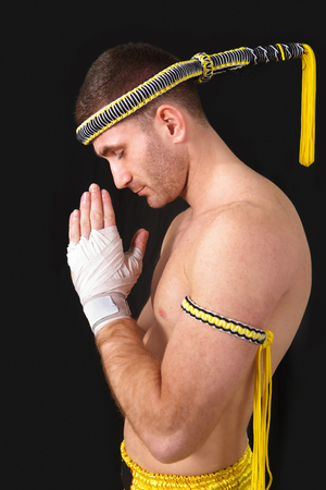 Martial arts, praying thai boxer photo