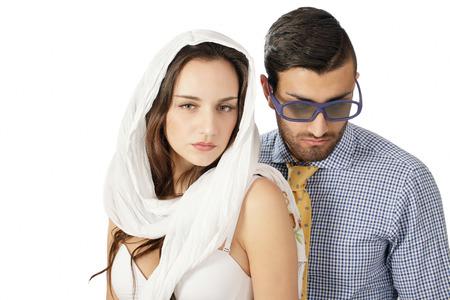 disparity: Mismatched couple, virtuous woman and rakish guy Stock Photo