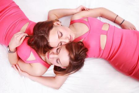 women s fashion: Beautiful twin women sleeping close together