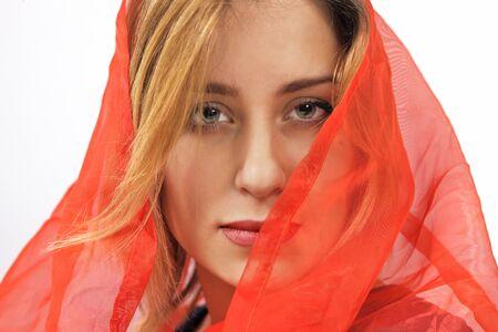 Beautiful woman in red silk headscarf photo