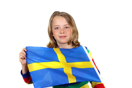 Cute child holding Sweden flag photo