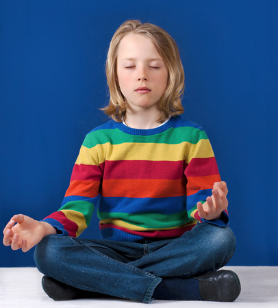 preteen  pure: Young boy practicing yoga meditation