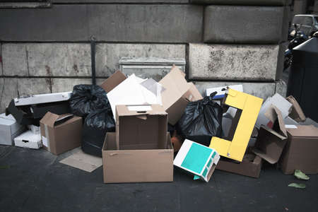unsightly: Garbage pile on roadside with cartons and bags