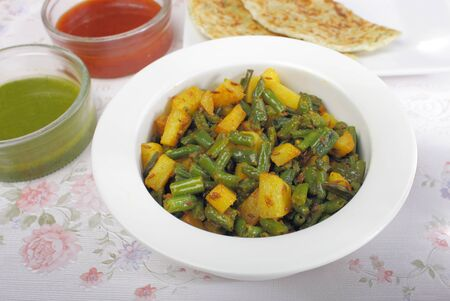 guar: Indian vegetable dish, greens beans and potatoes
