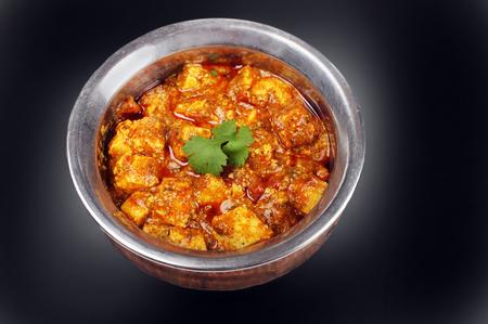 paneer: Paneer masala  classic Indian dish in vintage bowl Stock Photo
