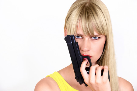 Cute female with gun, or cop in action photo