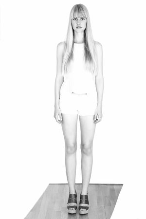 overexposed: Overexposed file photo of young woman in full length