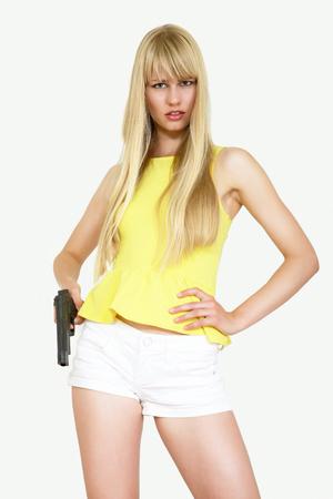 moll: Cute young woman holding a gun Stock Photo