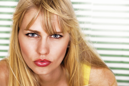 pursued: Beautiful sultry blonde woman Stock Photo