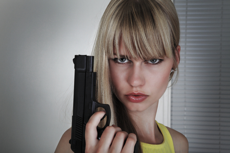 Girl gun action in alert mode Stock Photo