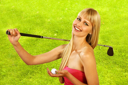 Girl goes golfing with happy smile photo