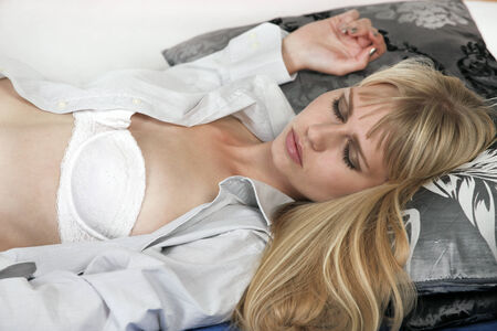 Woman sleeps on bed in disheveled condition