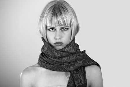 big women: Young woman with scarf, a black and white portrait  Stock Photo