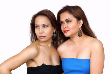 Two pretty multiethnic women looking to side photo