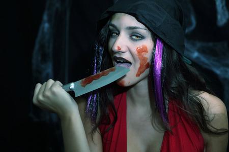 feast: Vampire blood feast, licking knife