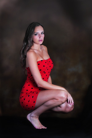 Model beauty portrait in red polka dot dress photo