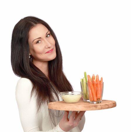 veggie tray: Pretty lady with healthy snacks, holding veggie dip on tray