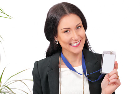 Happy business delegate showing her ID card Stock Photo
