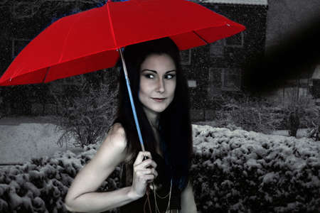 red umbrella: Beautiful woman with red umbrella on cold winter night