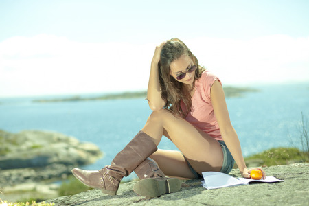 Summer life girl leisure reading at seaside Stock Photo