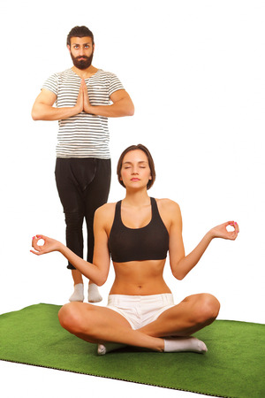 tantra: Couple practicing yoga, with focus on woman Stock Photo