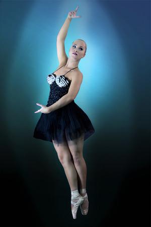 showmanship: Beautiful dancer in ballet pose, grace in motion