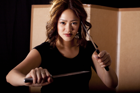 Girl practicing martial arts with knives photo