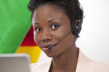 lady on phone: Helpline lady, with phone headset Stock Photo