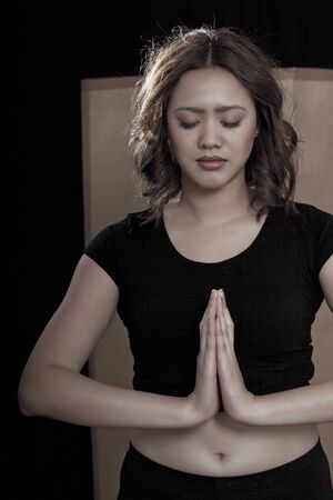 Praying martial art sportswoman photo