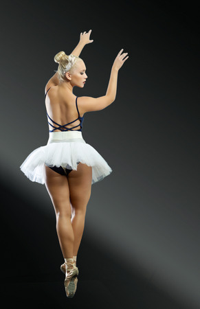 hair tied: Ballerina rear-view portrait in full length
