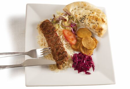 seekh: Plate of grilled kebab with accompaniments and garnish